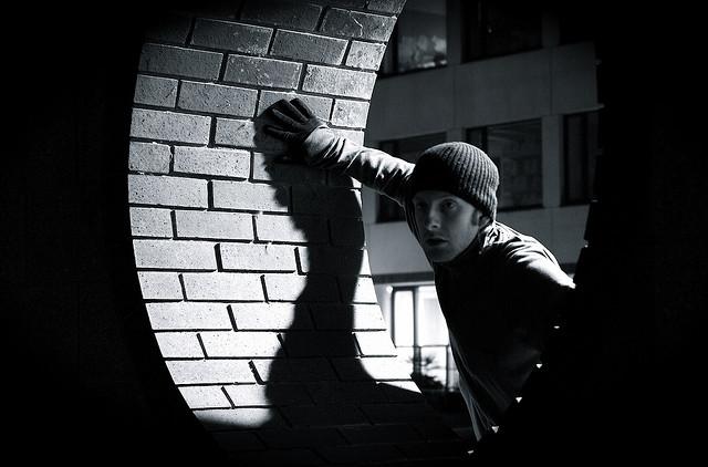 A burglar in a beanie.